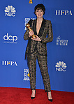a_Phoebe Waller-Bridge 136 poses in the press room with awards at the 77th Annual Golden Globe Awards at The Beverly Hilton Hotel on January 05, 2020 in Beverly Hills, California.