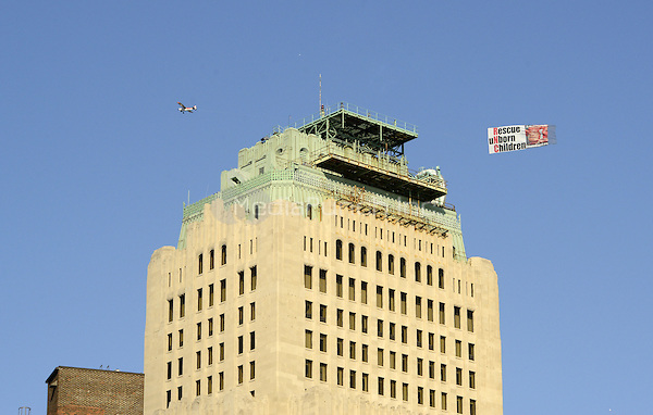 A pro-life banner is towed behind an airplane over a building near the Quicken Loans Arena, the site of the 2016 Republican National Convention in Cleveland, Ohio on Friday, July 15, 2016.<br /> Credit: Ron Sachs / CNP/MediaPunch<br /> (RESTRICTION: NO New York or New Jersey Newspapers or newspapers within a 75 mile radius of New York City)