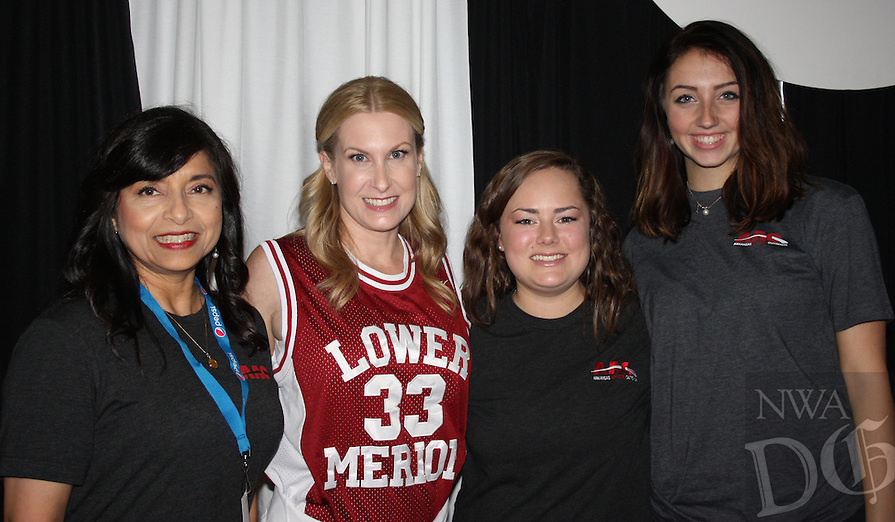 NWA Democrat-Gazette/CARIN SCHOPPMEYER Debbie Friess (from left), Erin Bridges, Francie Shaddox and Hannah Davis volunteer at the AAO Game Time Gala on Nov. 11.