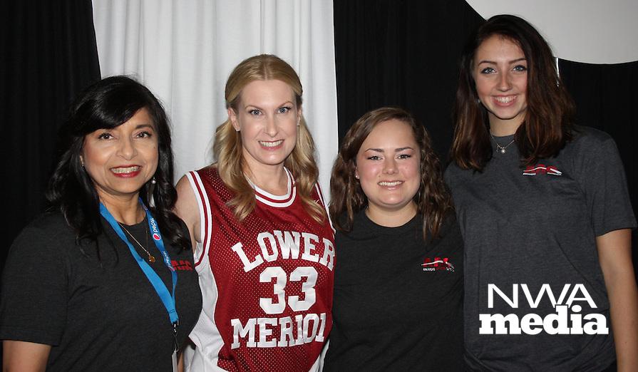 NWA Democrat-Gazette/CARIN SCHOPPMEYER Debbie Friess (from left), Erin Bridges, Francie Shaddox and Hannah Davis volunteer at the AAO Game Time Gala on Nov. 11.