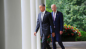 United States President Barack Obama with U.S. Vice President Joseph Biden by his side, walk from the Oval Office prior to the President delivering a statement on today's Affordable Care Act ruling from the U.S. Supreme Court in the Rose Garden of the White House on June 25, 2015.<br /> Credit: Dennis Brack / Pool via CNP