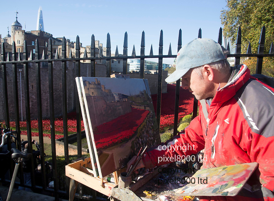 Pic shows: Huge crowds again today at the Blood Swept Lands and Seas of Red<br /> Poppy installation at the Tower of London with just days to  go before it is due to be removed.<br /> <br /> A painter capture the event<br /> <br /> <br /> <br /> Pic by Gavin Rodgers/Pixel 8000 Ltd