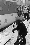 Mazatlan Mexico 1973. Chimp handler shows circus chimpanzee around town to drum up business for traveling circus.