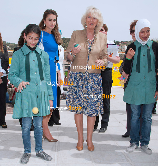 CAMILLA, DUCHESS OF CORNWALL JUGGLES A BALL WATCHED BY QUEEN RANIA.The Duchess participated in an activity of bouncing a ball and catching it with alternate hands with the school girls from Mahes Secondary School for Girls, Amman_12/03/2013.The Royal couple are on a tour of four Middle Eastern countries.