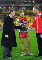 NZ prime minister John Key presents the Simpson-Henderson Trophy to Swans captain Kieren Jac and coach John Longmire during the Australian Rules Football ANZAC Day match between St Kilda Saints and Sydney Swans at Westpac Stadium, Wellington, New Zealand on Thursday, 24 May 2013. Photo: Dave Lintott / lintottphoto.co.nz