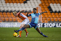 Anthony Stewart of Wycombe Wanderers battles Mark Cullen of Blackpool during the The Checkatrade Trophy match between Blackpool and Wycombe Wanderers at Bloomfield Road, Blackpool, England on 10 January 2017. Photo by Andy Rowland / PRiME Media Images.