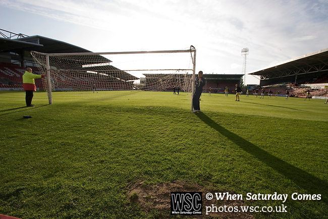Bangor City 0 FC Honka 1, 23/07/2009. Racecourse Ground, Europa League. Groundstaff erecting the goals before Bangor City's Europa League second round second leg tie against FC Honka from Finland at Wrexham's Racecourse Ground. The match had to be staged away from City's Farrar Road ground as it did not meet UEFA's stadium standards. The Finns won 1-0 in Wales to go through 3-0 on aggregate in front of 602 spectators in the first season of the newly-introduced competition which replaced the UEFA Cup. Photo by Colin McPherson.