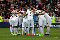 Swansea players huddle during the Premier League match between Sunderland and Swansea City at the Stadium of Light, Sunderland, England, UK. Saturday 13 May 2017