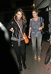 April 5th 2012..Jessica Alba leaving Matsuhisa restaurant  in Los Angeles wearing a long purple scarf orange purse smiling laughing hugging friends