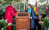 President Jonathan Veitch confers Emeritus Status to retiring faculty member Dale Wright<br /> Families, friends, faculty, staff and distinguished guests celebrate the class of 2018 during Occidental College's 136th Commencement ceremony on Sunday, May 20, 2018 in the Remsen Bird Hillside Theater.<br /> (Photo by Marc Campos, Occidental College Photographer)