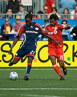 23 May 09: New England Revolution midfielder Shalrie Joseph #21 and Toronto FC defender Adrian Serioux #15 in action during a game between the New England Revolution and Toronto FC.Toronto FC won 3-1.