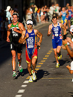 25 JUN 2011 - PONTEVEDRA, ESP - Mario Mola (ESP) leads Joao Perreira (POR) (left) and Todd Leckie (GBR) (right) on the run during the Elite Men's European Triathlon Championships in Pontevedra, Spain (PHOTO (C) NIGEL FARROW)