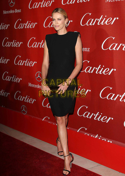 Charlize Theron.At The 23rd Annual Palm Springs International Film Festival Awards Gala Held At The Palm Springs Convention Center, Palm Springs, California, USA,.7th January 2012..arrivals full length dress slit split sandals ankle strap open toe black shoulder pads sleeveless .CAP/ADM/KB.©Kevan Brooks/AdMedia/Capital Pictures.