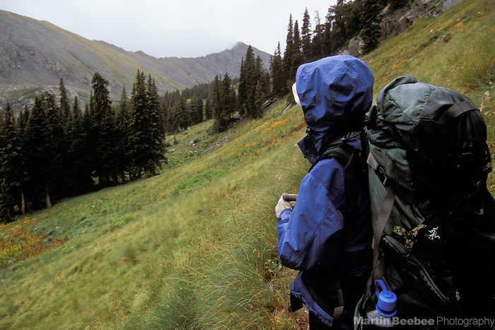 Backpacker on the rainy Venable-Comanche trail, Sangre de Cristo Wilderness, San Isabel National Forest, Colorado