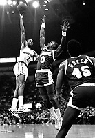 Warriors Terry Teagle against Seattle Supersonics Olden Polynice..(1990 photo/Ron Riesterer)