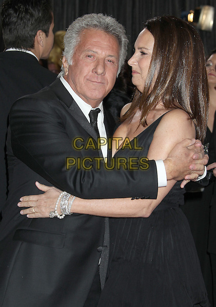 Dustin Hoffman, Lisa Gottsegen.85th Annual Academy Awards held at the Dolby Theatre at Hollywood & Highland Center, Hollywood, California, USA..February 24th, 2013.oscars half length dress profile married hug embrace husband wife black white tie suit shirt  side profile   .CAP/ADM/RE.©Russ Elliot/AdMedia/Capital Pictures.