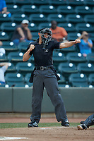 Home plate umpire Mike Snover calls a batter out on strikes during the Carolina League game between the Down East Wood Ducks and the Winston-Salem Dash at BB&T Ballpark on May 12, 2018 in Winston-Salem, North Carolina. The Wood Ducks defeated the Dash 7-5. (Brian Westerholt/Four Seam Images)
