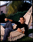 Two time Indianapolis 500 winner Helio Castroneves relaxes at home. He is in the poll position for the 2004 Indy 500.