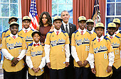 United States President Barack Obama and first lady Michelle Obama meet with the Jackie Robinson West All Stars, the 2014 Little League World Series U.S. champion, in the Oval Office of the White House, November 6, 2014 in Washington, DC.  <br /> Credit: Olivier Douliery / Pool via CNP