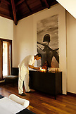 MAURITIUS, Chemin Grenier, South Coast, a massage therapist prepares a room for a guest at the spa, Hotel Shanti Maurice