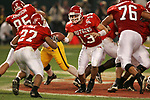 Rutgers Scarlet Knights quarterback Ryan Hart hands the ball off during the Insight Bowl against theArizona State Sun Devils at Chase Field in Phoenic, AZ on December 27, 2005.  The Sun Devils won 45-40.