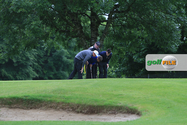 Ruairi O'Connor (Co. Sligo), Ross Kelly (Tuam) and Stephen Brady (Galway) examine the pin on the 17th green during Round 4 of the Connacht Stroke Play Championship at Athlone Golf Club Sunday 11th June 2017.<br /> Photo: Golffile / Thos Caffrey.<br /> <br /> All photo usage must carry mandatory copyright credit     (&copy; Golffile | Thos Caffrey)