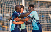 Luke O'Nien (centre) & Nathan Tyson celebrate with goalscorer Adebayo Akinfenwa of Wycombe Wanderers during the Friendly match between Wycombe Wanderers and AFC Wimbledon at Adams Park, High Wycombe, England on 25 July 2017. Photo by Kevin Prescod.