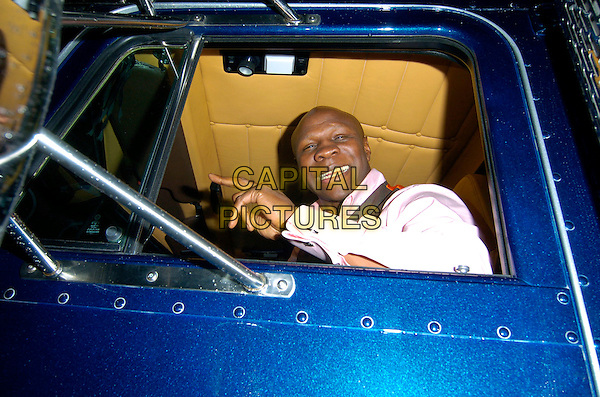 CHRIS EUBANK.Spotted driving through Mayfair, outside Cipriani restaurant, in his big American truck, London, England, August 14th 2007..half length sitting driver vehicle lorry blue funny car.CAP/CAN.©Can Nguyen/Capital Pictures