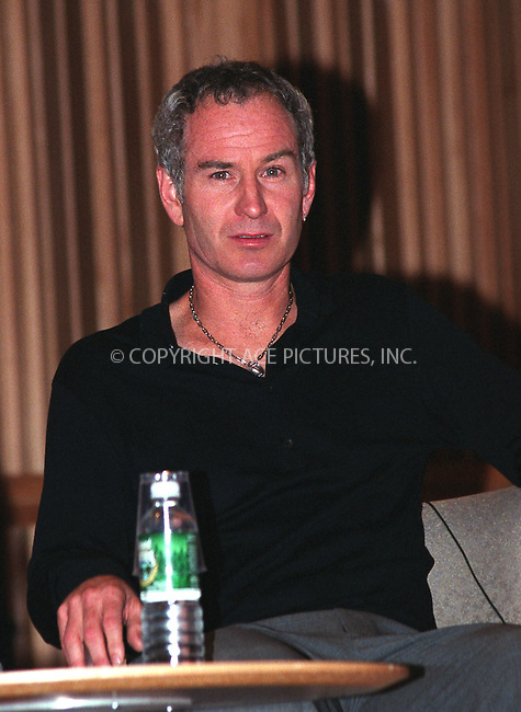 "Former tennis star John McEnroe promotes his latest book, ""You Cannot be Serious"" in New York, June 11, 2002. REF: AMUS2099. Please byline: Anthony Moore/NY Photo Press.   ..*PAY-PER-USE*      ....NY Photo Press:  ..phone (646) 267-6913;   ..e-mail: info@nyphotopress.com"