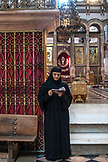 ISRAEL, Jerusalem, a nun reading a prayer at the Church of the Holy Sepulchre