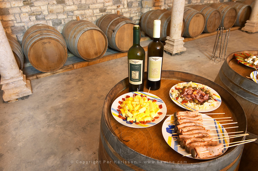 Bottles of wine and Albanian appetizers: cheese olives sausage... Cobo winery, Poshnje, Berat. Albania, Balkan, Europe.