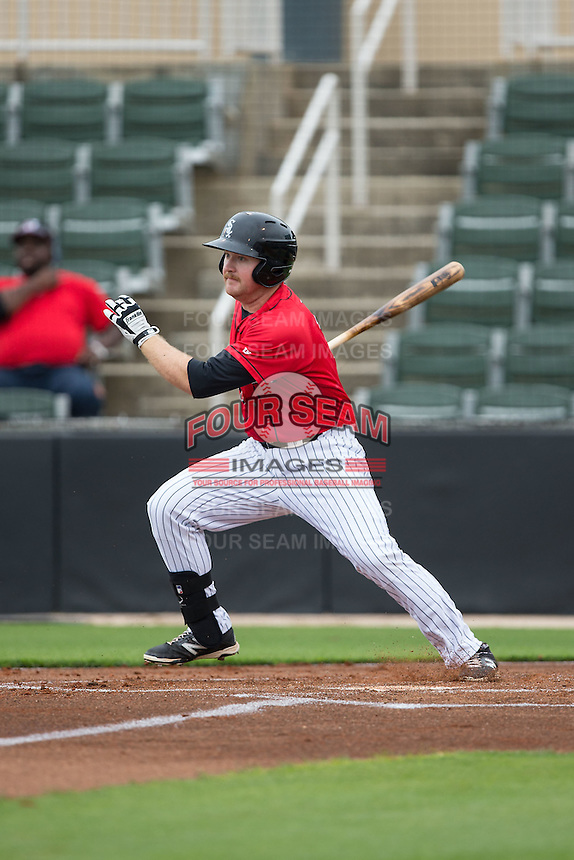 Mason Robbins (10) of the Kannapolis Intimidators follows through on his swing against the Hickory Crawdads at CMC-Northeast Stadium on April 17, 2015 in Kannapolis, North Carolina.  The Crawdads defeated the Intimidators 9-5 in game one of a double-header.  (Brian Westerholt/Four Seam Images)