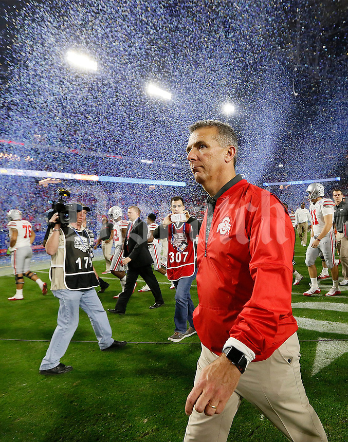 Ohio State Buckeyes head coach Urban Meyer walks off the field following their 31-0 loss to Clemson in the College Football Playoff semifinal Fiesta Bowl at University of Phoenix Stadium in Glendale, Arizona on Dec. 31, 2016. (Adam Cairns / The Columbus Dispatch)