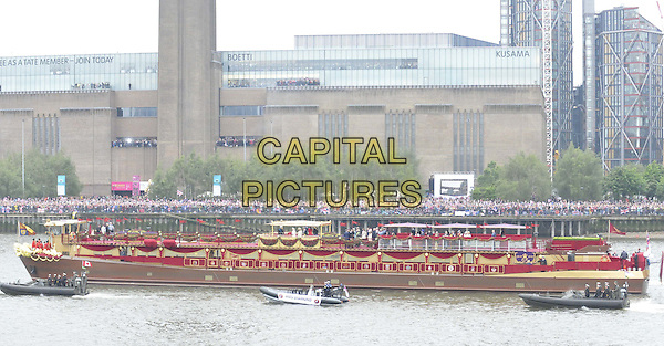 The Spirit of Chartwell.sailing ( past the Tate Gallery ) as part of the Diamond Jubilee River Pageant, River Thames, London, England..June 3rd, 2012.gv general view water river building boat ship crowds.CAP/CAN.©Can Nguyen/Capital Pictures.