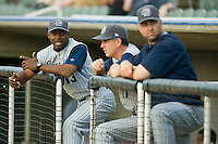 Lake County Captains manager Aaron Holbert #13 talks with his coaching staff in the visitors dugout at Fieldcrest Cannon Stadium May 1, 2009 in Kannapolis, North Carolina. (Photo by Brian Westerholt / Four Seam Images)