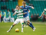 Celtic v St Johnstone...23.01.16   SPFL  Celtic Park, Glasgow<br /> Stefan Johansen holds off David Wotherspoon<br /> Picture by Graeme Hart.<br /> Copyright Perthshire Picture Agency<br /> Tel: 01738 623350  Mobile: 07990 594431
