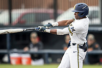 Michigan Wolverines outfielder Christian Bullock (5) swings the bat against the Maryland Terrapins on April 13, 2018 in a Big Ten NCAA baseball game at Ray Fisher Stadium in Ann Arbor, Michigan. Michigan defeated Maryland 10-4. (Andrew Woolley/Four Seam Images)
