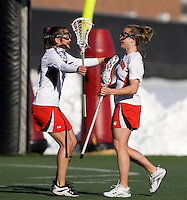 Caitlyn McFadden (3) celebrates her goal with teammate Casey Kelly (4)  at the practice turf field in College Park, Maryland.  Maryland defeated Richmond, 17-7.