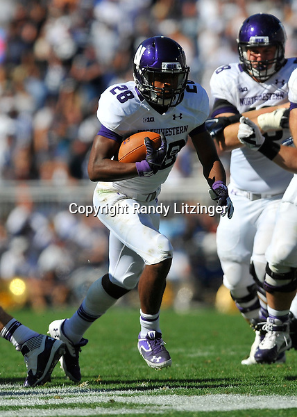 27 September 2014:  Northwestern RB Justin Jackson (28) runs up the middle. The Northwestern Wildcats defeated the The Penn State Nittany Lions 29-6 at Beaver Stadium in State College, PA.