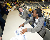 The University of Michigan women's basketball team signed autographs during the Crisler Arena Open House in Ann Arbor on Friday, September 23, 2011.