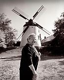 AUSTRIA, Podersdorf, portrait of Elizabeth, a woman who lives across the street from the windmill, Burgenland (B&W)