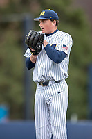 Michigan Wolverines pitcher Tommy Henry (47) looks to his catcher for the sign against the Rutgers Scarlet Knights on April 27, 2019 in the NCAA baseball game at Ray Fisher Stadium in Ann Arbor, Michigan. Michigan defeated Rutgers 10-1. (Andrew Woolley/Four Seam Images)