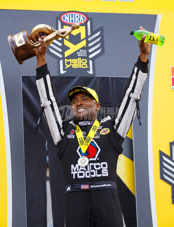 Jul 10, 2016; Joliet, IL, USA; NHRA top fuel driver Antron Brown celebrates after winning the Route 66 Nationals at Route 66 Raceway. Mandatory Credit: Mark J. Rebilas-USA TODAY Sports