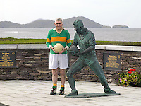 Waterville native Mick O'Dwyer beside a statue inveiled to him in 2012. Photo: Don MacMonagle