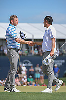 Nate Lashley (USA) shakes hands with John Huh (USA) on 18 following their round 4 of the Houston Open, Golf Club of Houston, Houston, Texas. 4/1/2018.<br /> Picture: Golffile | Ken Murray<br /> <br /> <br /> All photo usage must carry mandatory copyright credit (&copy; Golffile | Ken Murray)