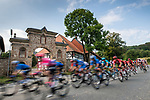 The peloton speed by during Stage 1 of the Deutschland Tour 2019, running 167km from Hannover to Halberstadt, Germany. 29th August 2019.<br /> Picture: ASO/Marcel Hilger | Cyclefile<br /> All photos usage must carry mandatory copyright credit (© Cyclefile | ASO/Marcel Hilger)