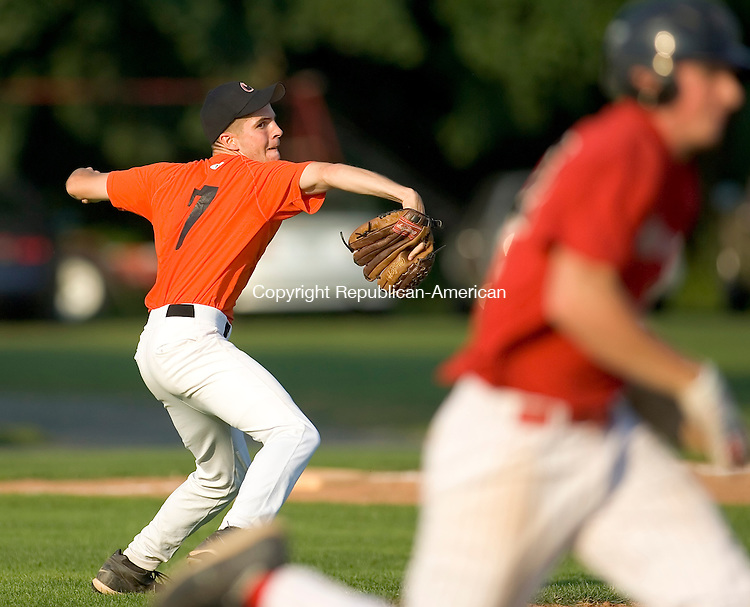WATERTOWN CT--16 JUNE 2007--062607JS01 - Oakville's Chris Doyle throws out a runner after fielding the ball during their American Legion baseball game against Waterbury Tuesday at Taft School in Watertown.<br /> Jim Shannon / Republican-American