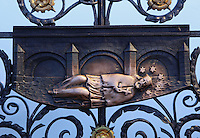 Detail of bronze relief of St John of Nepomuk on the Charles Bridge or Karluv most, built 1357 - 15th century over the Vltava river, Prague, Czech Republic. In 1393, the Bohemian king Wenceslaus ordered St John of Nepomuk (the country's patron saint) thrown off the Charles Bridge because he would not reveal the confessions of the queen. This site on the bridge marks the spot he was thrown. Legend has it that stars appeared around the saint's head the moment he hit the water. It has become traditional to touch the bridge here to bring good luck and to ensure that the visitor will return to the city of Prague. The historic centre of Prague was declared a UNESCO World Heritage Site in 1992. Picture by Manuel Cohen
