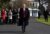 United States President Donald J. Trump walks towards the press while departing the White House December 8, 2018 in Washington, DC. Trump announced White House Chief of Staff John Kelly will resign by the end of the year before departing for the 119th Army-Navy Football Game in Philadelphia, Pennsylvania.<br /> Credit: Olivier Douliery / Pool via CNP