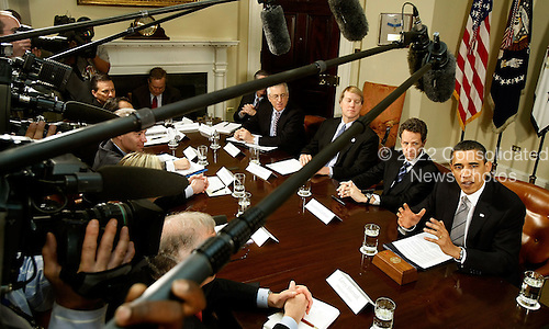 Washington, DC - April 23, 2009 -- United States President Barack Obama (R) talks to the news media after a meeting with officials from the credit card industry, including (L-R) Master Card Worldwide U.S. Markets Director Christopher McWilton, Discover Financial Services CEO David Nelms and Treasury Secretary Timothy Geithner (2nd R) at the White House, Thursday, April 23, 2009 in Washington, DC. CEOs from Visa, Mastercard, American Express and the credit card divisions at about a dozen of the largest banks were invited to speak with Obama about high fees and predatory lending practices. The timing is hard for the companies as the House Financial Services Committee approved legislation cracking down on credit card billing practices on Wednesday.  .Credit: Chip Somodevilla - Pool via CNP